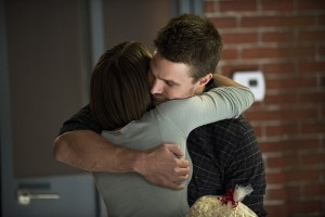 "Arrow -- ""The Secret Origin of Felicity Smoak"" -- Image AR305b_0154b -- Pictured (L-R): Willa Holland as Thea Queen and Stephen Amell as Oliver Queen -- Photo: Cate Cameron/The CW -- © 2014 The CW Network, LLC. All Rights Reserved."